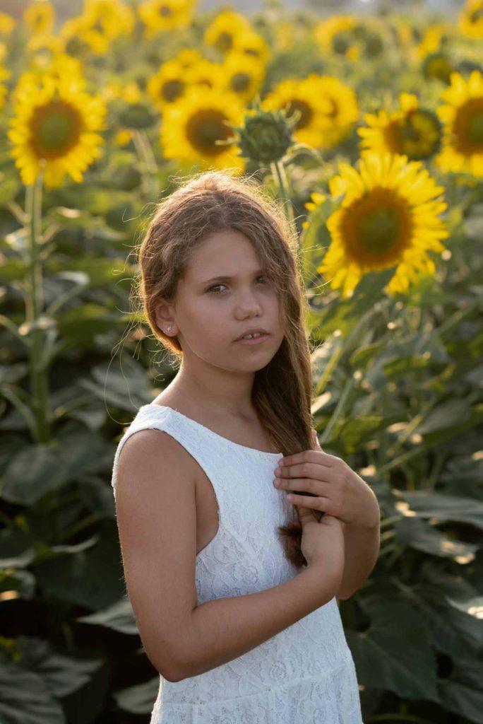 fotografo bambini e famiglie la spezia ritratto tra i girasoli